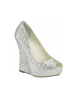 "The Benjamin Adams Mila wedge is the most beautiful bridal wedge to date. The perfect combination of a modern wedge and peep toe design accented with all over rhinestones makes this style in a league of it's own. The 4 3/4"" wedge heel is ideal for any surface and is complimented with a 1"" platform front for comfort."