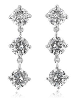 "When a simple stud isn't quite enough, this dangle style earring gives you drama and sparkle for your special occasion. The pair is made of top quality cubic zirconia in a gorgeous diamond quality setting of sterling silver and platinum. 4.5 carat, total weight, each earring measures 1"" long and arrives in a gift box."