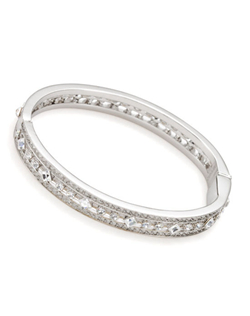 "This beautiful bangle bracelet will add a touch of elegance to your wedding day look. Clean classic and traditional, this bangle goes with almost any look. Measures 6 3/4""."
