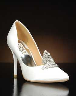 Pointed toe pump with crystal and metal embellishment