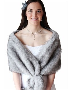 Our popular Chinchilla Grey Faux Fur Stole is the perfect winter bridal accessory and formal evening wear.  It is made of the highest quality and is a must see item. Other Colors Available such as Black, Ivory, Pure White and Chinchilla Grey.