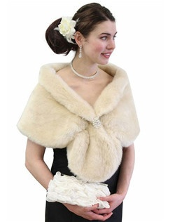 Our Faux fur wrap bridal stole Champagne with collar is a great faux fur accessory for colder weather formal events and weddings. This satin lined faux fur stole will be sure to impress. Other Colors Available such as Black, Ivory, Silver and Snow White, Sable, Navy Blue, Purple, Champagne