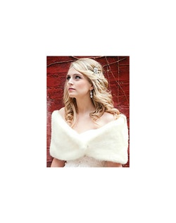Beautiful faux fur mink shoulder wrap with hook closure. The lavish faux fur material is soft and realistic as well as warm. The perfect accent to any cold weather wedding or event.