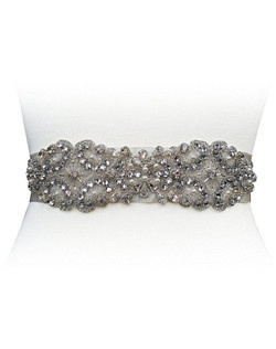 This gorgeous belt eludes Old Hollywood Glamour. The Mae has a beautiful mix of crystals, pearls and rhinestones with a soft scalloped edge. Design measures 2 inches x 12 1/2. Ribbon measures 1 1/2 inches by 2 yards.