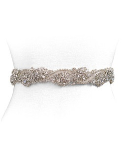 This vintage infused crystal beading radiates elegance. The exquisite detail and the scalloped edge brings a subtle romance to any look. Beading measures 1 1/4 by 18 inches. Ribbon measures 1/2 inch by 2 yards