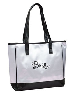 Every bride s must-have tote for all of the information and ideas. This tote bag offers major room for all your essentials and a cute way to carry them! This tote features the word Bride across the front, a contrasting black satin piped edge and black satin shoulder strap for easy carrying.