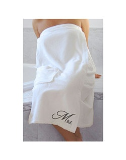 "Made of soft white terrycloth, this relaxing bath wrap measures 34"" x 30-67"" (size difference due to elastic band). It is embroidered with the word ""Mrs."" in black. One pocket is included. Matching ""Mr."" bath wrap also available. Perfect for your honeymoon!"