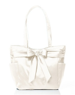 Matte satin tote with external pockets matches Dessy's top bridesmaid colors. It's the stylish way for your bridesmaids to keep their essentials (or yours) organized during the wedding festivities. Magnetic snap closure. 12.5 X 6.75 X 11 inches.