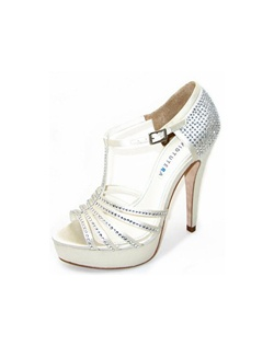 "The David Tutera Wonderful is a T-strap platform design with a retro feel. The multi-strap design and closed back are reminiscent of a vintage dance shoe. The updated crystal accents give this style major shine. Heel height measures 5 1/4"" with a 1"" platform front.  Available in Ivory."