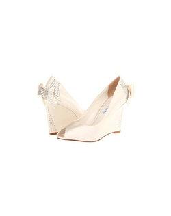 "The David Tutera Blue is a sophisticated wedge design with a peep toe front. The simple and sleek design features a flat bow accent on the heel and rhinestones from the heel to the bow. The heel measures 3"".  Available in Ivory."