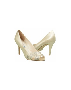 "The David Tutera Specialty shoes are ultra classic and perfect for any event. The simple peep toe and criss-cross strap design is easy to wear and is flattering on the foot. The fully enclosed pump is stable and comfortable while staying up to date with a rhinestone front that glitters with each step. The heel measures 3 1/2"". Available in Ivory satin."