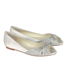 The Benjamin Adams Andie is a stunning crystal encrusted flat with peep toe design. The criss cross front design sparkles beautifully with encrusted rhinestone detailing. The flat sole is the perfect fit. Great for the  bride looking for a lot of glam and comfort all in one. Available in Ivory Duchess Silk.