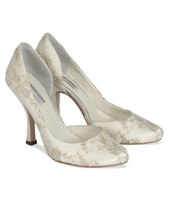 "The Benjamin Adams Elizabeth shoes are a beautifully embroidered closed toe pump. The Ivory silk is over layed with a sheer Organza material that is embroidered with gold threading. The round toe is comfortable and supportive. Heel height measures 3 3/4"". Available in Ivory silk/organza."