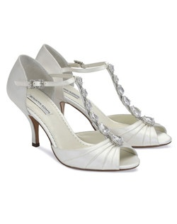 "The Benjamin Adams Mia is a gorgeous rhinestone T-strap style with peep toe front. The T-strap design is accented with beautiful Tear drop shaped Crystal accents and light pleating detail in the front. The heel measures 4 1/4"". Available in Ivory Duchess Silk."