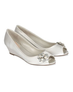 "The Frosting by Pink is an adorable low wedge with pearl and crystal brooch accent at the toe. The peep toe design adds interest while the basic fully enclosed style is comfortable. The low 1 3/4"" heel is great for any event. Available in Ivory satin."