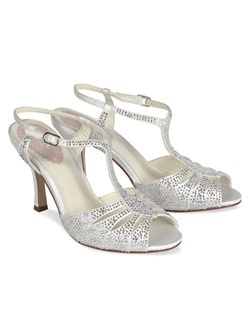 "The Glow by pink is a retro styled T-strap sandal encrusted in glittering rhinestone accents. The beautiful multi-strap design is eye catching and comfortable. Heel height is 3 1/4"" with an adjustable ankle strap. Available in Ivory."