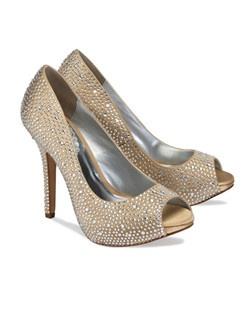 "The Luxe by Pink makes a sparkling statement. The fully closed pump design is complimented with an updated platform  and peep toe front. The heel measures 4 1/4"". The Luxe style is encrusted in glittering rhinestones all over the vamp and fully up the heel. Available in Ivory, Silver, Champagne, Blue and Fuchsia."