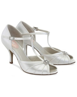 "The White Dyeable Pink Perfume shoes are a beautiful retro work of art. The timeless T-strap design is elegant and sophisticated. The peep toe design adds a dash of interest while spotlighting the pearl and crystal accent brooch. The Heel measures 2 3/4"" and is perfect for dancing the night away. Available in Ivory satin."
