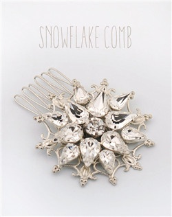 Handmade Swarovski crystal snowflake hair comb, available in silver or gold.