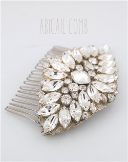 Handmade Swarovski crystal statement hair comb, available in silver or gold.