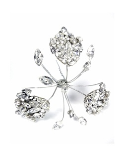 Erin Cole's unique crystal hair pin sprays are a delicate, feminine addition to your bridal look. Three sparkling Swarovski crystal encrusted silver filigree leaves accented with crystal rhinestone sprays. These are so versatile and can be worn with many up-do's. Wear alone or in multiples. Set on a hair pin.