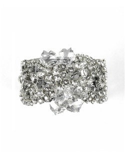 This stunning cuff is covered in Swarovski crystal rhinestones packing maximum sparkle with an elegant, stylish look! A must have for the jewelry box to wear again for formal events! Set on a silver filigree cuff and accented with clear crystal embellishments in the center.