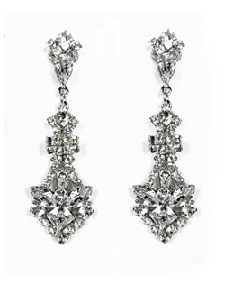 These stunning Swarovski crystal drop bridal earrings are vintage-inspired must-haves. Features a geometric crystal drop design with navette, square, and round brilliant crystals set on silver filigree. Suspended by a crystal embellished post.