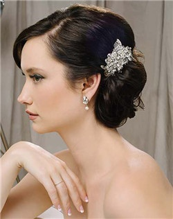 """Inspired by the popularity of the Lorraine headpiece, the filigrees in this delicate little clip are accented by a gorgeous assortment of Swarovski crystal stone and freshwater pearls—stunning! Piece measures 2-3/4"""" x 2""""."""