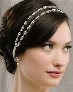 A double strand of tiny silver filigrees, Swarovski stones and genuine pearls are the perfect accent to your 'do. Secures at the back with satin ribbons. Available in diamond white and pale ivory.