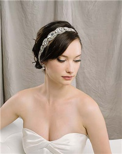 """This is hands-down our favorite design of the new season. Hundreds of glittering Swarovski crystals make this hair ribbon a true knock-out. And for extra points—it can also be worn as a sash! Secures in back with satin ties. Approximately 1.5"""" wide with 19"""" of total beading."""