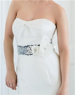 Part romance, part rock-n-roll, this laser-cut faux leather sash is embellished with our hand-folded silk origami roses and a generous sprinkling of Swarovski stones. A truly stunning piece that will bring your gown up to the next level! Available in diamond white, pale ivory and black. Faux leather is available only in black.