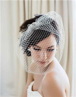 One of the most popular shapes, the Pout veil, now all glammed up in French net with a gorgeous silver filigree and Swarovski stone accent at the comb. Wear it over your face for the ceremony then flip it around for the reception--it's two in one! Available in diamond white, pale ivory and black.