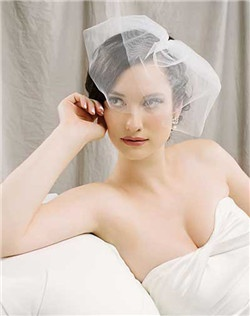 This double layer flirt veil is made up of two angled layers and is just as sassy as can be. It's easy to place this piece on your head so that your lips are exposed for that all important first kiss.