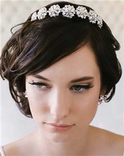 This is a stunning vintage rhinestone tiara that is not only beautiful but comfortable. Available in silver only.