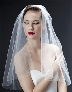 You can't beat this classic look! A gently curving drop veil with the tiniest of pencil trims. Subtle, sophisticated, perfect! Please select diamond white, pale ivory, or black. Available in any length. Please select preferred length and specify exact length preferred.