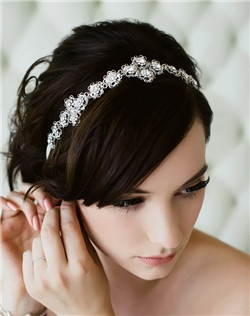 This gorgeous headband features linked filigree and hair ribbon together to create a glittering vintage look that can be worn in your hair OR around your waist! Available in diamond white, pale ivory and black.