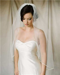 "Classic veil with 1/8"" silk ribbon trim. Available in diamond white and pale ivory. Shown in 40"" length."