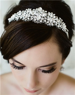 Like a million diamonds, carefully hand-set Swarovski stones adorn this tapering filigree hair ribbon. Also available as a sash! Available in diamond white, pale ivory and black.