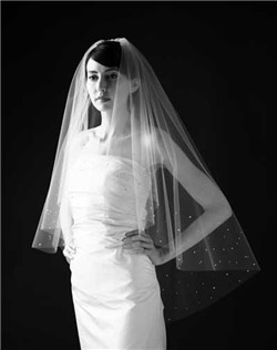 Petal veil with Swarovski rhinestones heavily scattered around edge. Sara is obsessed with perfection and puts the rhinestones on the inside of your veil also...no ugly rhinestone backs! Available in diamond white or pale ivory.