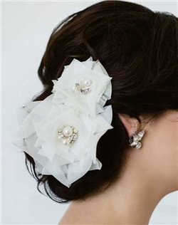 Adding this set of hand folded silk origami roses to your hair is the perfect way to achieve a refined but romantic look. Swarovski stones and pearls accent the centers of these flowers. Available in diamond white or pale ivory.