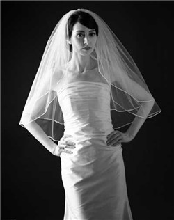 "Classic two-tier veil with freshwater pearl & Swarovski crystal detail on soutache trim. Available in diamond white and pale ivory. Shown in 27""/30"" lengths."