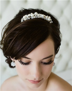 Bubbly Swarovski pearls and crystals are accented by glittering Swarovski stones on this comb that is a perfect accent to almost any hairstyle. Available in diamond white or pale ivory.