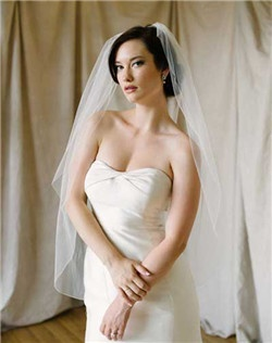 Meghan is a slipper veil with pencil edge. Classic and clean with elongated line.
