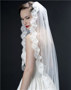 "Who can resist the luxury of authentic Alencon lace from France? The lace on this veil is 2"" wide and scallops perfectly around your face. C'est magnifique!"