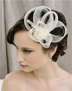Gracefully swirling loops of horsehair ribbon make this beautiful little hair clip the perfect compliment to almost any style. Wear it in the front like a hat, or further back on your head and it almost looks like a flower. How fun! Available in diamond white, pale ivory and black.