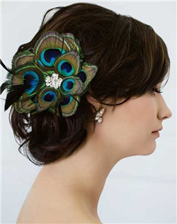 A gorgeous spray of feathers accented by a pile of Swarovski stones make up this clip on flower. If you're looking for something a little more organic, check out the natural and bleached peacock styles tres chic! Available in diamond white, pale ivory peacock and bleached peacock.