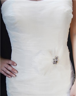 Feathers on a sash?? Yes, please!! The horsehair ribbon becomes a part of your gown, and the off-center feather & Swarovski rhinestone detail looks positively luscious! Available in diamond white, pale ivory, or black.