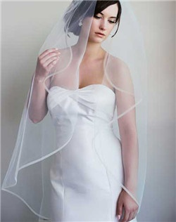 The delicate horsehair trim on this fountain shaped veil is absolutely timeless and just seams to float around your face and gown. Available in diamond white or pale ivory.