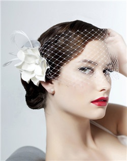This piece is a real knockout! French netting....Swarovski rhinestones...feathers...horsehair braid....a custom pressed bamboo flower....need we say more? Wear the veil behind/around the flower for a fun reception look! Available in diamond white, pale ivory, or black. Flower is as shown in natural.
