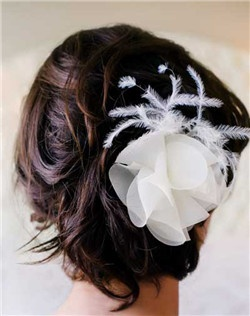 Super feminine silk organza flower with understated ostrich feather detail. (Available without feathers by request). Available in diamond white, pale ivory, or black.